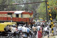 A file photo of an unmanned railway crossing in the City.