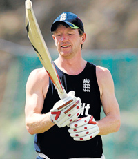 Mighty bat:  England captain Paul Collingwood inspects his bat on Wednesday ahead of the semis against Sri Lanka. AP