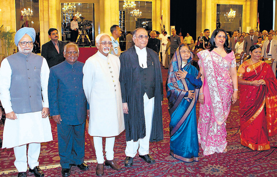 New Chief Justice of India Justice Sarosh Homi Kapadia (centre) and his wife (2nd right) with President Pratibha Patil, Vice President Hamid Ansari, Prime Minister Manmohan Singh and former Chief Justice of India K G Balakrishnan after taking oath at the Presidential Palace in New Delhi on Wednesday. PTI