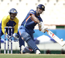 Suresh Raina hits a six during the World Twenty20 on Tuesday in in Gros Islet. AP