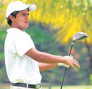 Striking a pose: Ashbeer Saini follows the progress of the ball during his second-round 68 in the Asia Pacific Junior Golf Championship at the Eagleton Golf Resort on Friday. DH photo