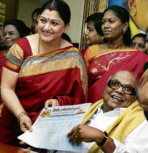 New turf: Tamil actress Kushboo with Tamil Nadu Chief Minister and DMK President M Karunanidhi while formally joining the party in Chennai on Friday. PTI