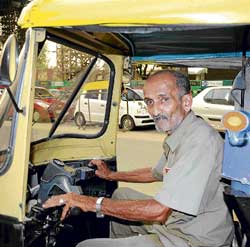 this is his world: Krishna Kamath in his autorickshaw. dh Photo