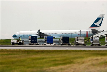 A Cathay Pacific passenger plane sits on the tarmac at the Vancouver International Airport on Saturday, AP