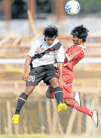 Sibra Narzaary of Vasco (left) and Prasoon R of Malabar United battle for possession during their I-League Second Division match in Bangalore on Sunday. DH Photo