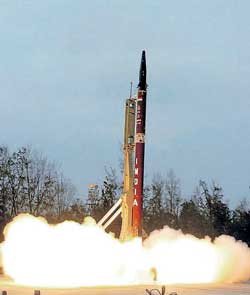 Nuclear-capable Agni-II ballistic missile, with a strike range of 2000 km, takes off from Wheelers Island, in the Bay of Bengal off Orissa coast, on Monday. PTI