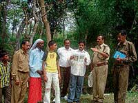 RFO M S Chinnappa giving information to volunteers on identifying blocks before beginning elephant census in Anekadu reserve forest near Kushalnagar. Forester K P Somanna, volunteers B C Muruli Madaiah and H K Thilagar are seen. dh photo