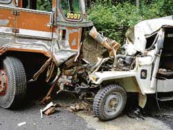 beyond recognition: The mangled remains of the jeep which met with an accident at Kanakamajalu in Sullia on Monday. DH Photo