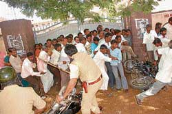 Police resorted to mild lathi charge to disburse the mob outside the STJ College where counting was held. dh photo