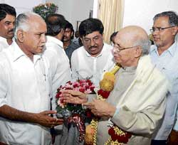 birthday wishes: Chief Minister B S Yeddyurappa greeting Governor H R Bhardwaj on his 73rd  birthday, at Raj Bhavan in Bangalore on Monday. Ministers R Ashok, Murugesh Nirani and Suresh Kumar are also seen.