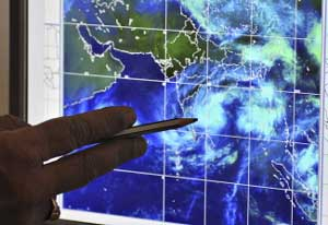 S. Venkateshwar Rao, assistant meteorologist from the Flood Meteorological Office, points to movements of Cyclone Laila on a computer screen to journalists at the Indian Meteorological Department (IMD) in Hyderabad on Wednesday. AFP