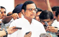 Home Minister P Chidambaram talks to mediapersons outside his office in New Delhi on Tuesday. PTI