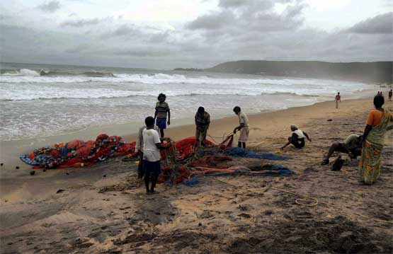 Fishermen taking precautions after a warning for cyclone 'Laila' in Vishakhapatnam on Wednesday. PTI