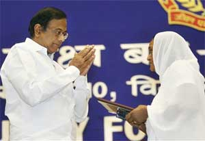 Home Minister P Chidambaram greeting the widow of Constable Narendra Prasad after presenting the Jeevan Raksha Padak posthumously during BSF's 8th Investiture Ceremony in New Delhi on Friday. PTI