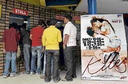 eager People queue to purchase tickets for the newly  released Bollywood movie Kites in Bangalore on Friday. afp