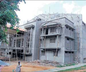 Grand Edifice: An exterior view of the indoor stadium which is under construction near the Government Boys College in Kolar. DH Photo