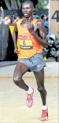 Tenacious: Titus Mbishei of Kenya en route to the men's title at the World 10K on Sunday. DH Photo/ Kishor Kumar Bolar