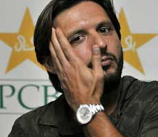 Pakistani cricket captain Shahid Afridi gestures as he answers a question during a press conference in Lahore on Tuesday. AFP