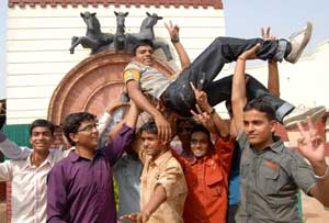 soaring high: IIT-JEE qualifier Abhishek Kumar Bharti's friends lift him up to celebrate his result.