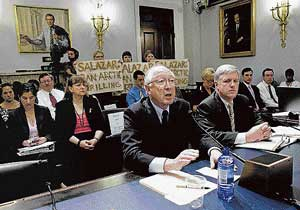 damage control Protestors from Greenpeace stand as secretary of the interior Ken L Salazar speaks before the House Committee on Natural Resources during a hearing on the oil spill in the Gulf of Mexico in Washington on Wednesday. nyt