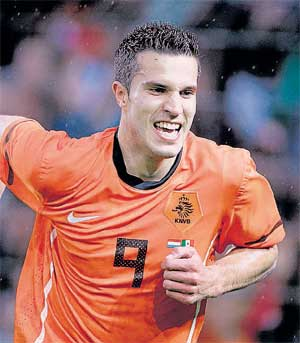 Enforcer: Holland's Robin van Persie celebrates after scoring against Mexico in a World Cup friendly on Wednesday. AP
