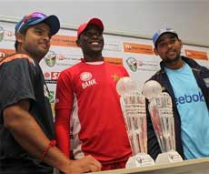 Zimbabwean Cricket captain, Elton Chigumbura, centre, Sri Lankan Cricket captain,Tillakaratne Dilshan, right and Indian Cricket Captain ,Suresh Raina, left, at the unveiling of the Micromax series trophy at a local hotel in Bulawayo, about 500 kilometers south of Harare on Thursday. AP