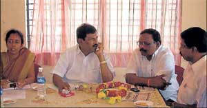 MLA G K Venkatashivareddy addressing a meeting of the officials of the various departments at the Mini Vidhana Soudha auditorium at Srinivaspur on Friday. Tahsildar S Roopashree, former president of the Zilla Panchayat M Shrinivasan and Zilla Panchayat member G Rajanna are seen. DH PHOTO