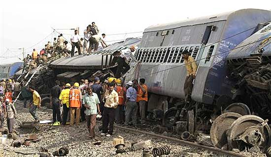 Rescue workers gather at the scene of train accident near Jhargram, in West Bengal on Friday. AP