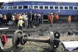 Rescue workers and police gather at the scene of train crash in Jhargram, West Bengal on Friday.AP