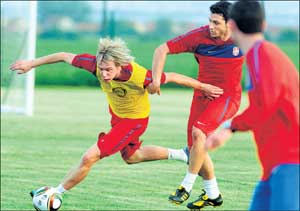 Intense training: Serbia's Milos Krasic (left) vies with team-mate Gojko Kacar during a training session at Kovilovo. AFP