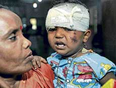 A kid who was rescued from the derailed Gyaneshwari Express at a hospital in Midnapore on Saturday. PTI