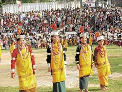 tribals Khasi women performing a traditional dance.