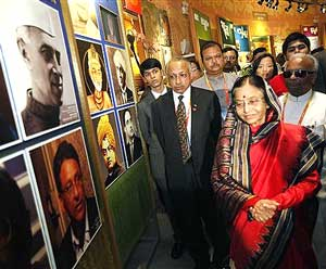 President Pratibha Patil admires photographs at the Indian Pavilion in Shanghai Expo 2010 during her visit to China on Sunday. PTI