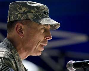 Gen. David Petraeus, the new commander of U.S. and NATO forces in Afghanistan, speaks during a ceremony in which he formally assumed the command on Sunday in Kabul. AP