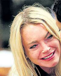 Lindsay Lohan cries after being sentenced on Tuesday. AP
