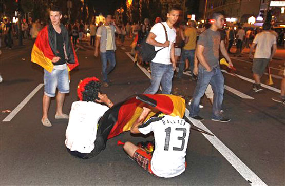 German fans react after watching the World Cup soccer match between Germany and Spain taking place in South Africa, at a public viewing area in Munich, southern Germany, on Wednesday .AP Photo