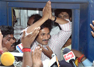 Congress MP Y.S.Jagan Mohan Reddy greeting his supporters before boarding a train for his Odarpu yatra at the Secunderabad railway station on Wednesday. PTI Photo