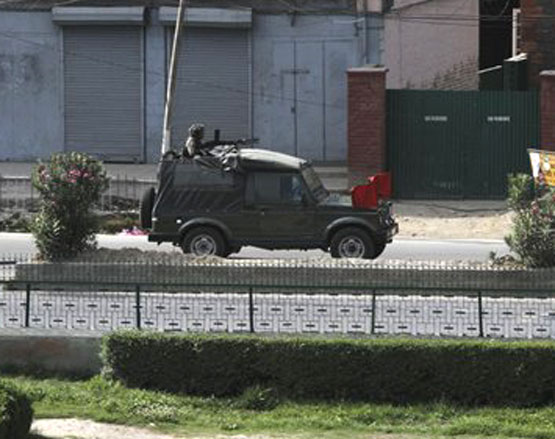 An Indian Army jeep patrols a deserted street during curfew in Srinagar on Wednesday. AP Photo