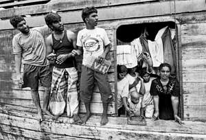 In search of new life: A picture taken on October 22, 2009, shows Sri Lankan asylum-seekers on board their boat moored at Merak seaport in Serang district on Indonesia's Java island, after they were stopped by Indonesian authorities on their way to Australia. AFP
