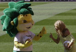 Colombia's singer Shakira, right, pose for photographers with the World Cup soccer mascot Zakumi, as she attends an event at the Soccer City stadium in Johannesburg, South Africa, Saturday July 10, 2010. Where on Sunday will be held the final match of the World Cup between Netherlands and Spain.AP