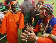 Shamans stand around a replica of the Netherlands' soccer jersey as they perform a ritual to send good vibes to the Netherlands' team in Lima on Friday .AP