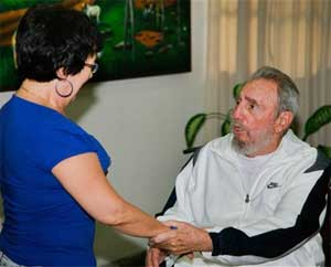 Cuban leader Fidel Castro, right, greets an unidentified woman during a visit to the National Center for Scientific Investigation in Havana on July 7, 2010. AP Photo/Cubadebate-Alex Castr