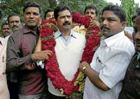 Former minister Hartal Halappa being welcomed by his followers on his arrival at Shimoga on Sunday. KPN