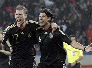 Germany's Sami Khedira, right, celebrates with teammate Per Mertesacker after scoring his side's third goal during the World Cup third-place soccer match between Germany and Uruguay at Nelson Mandela Bay Stadium in Port Elizabeth, South Africa on Saturday. AP