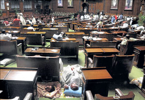 MLAs sleeping in between the Legislative Assembly seats during their continued protest against the government in Vidhana Soudha on Tuesday night. DH PHOTO