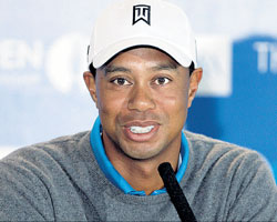Tiger Woods addresses the media ahead of the British Open at St Andrews on Tuesday. AP