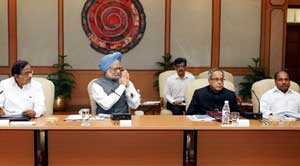Prime Minister Manmohan Singh, flanked by Home Minister P Chidambaram, Finance Minister Pranab Mukherjee and Defence Minister A K Antony, presiding over a meeting of Chief Ministers of Naxal-affected States, in New Delhi on Wednesday. PTI