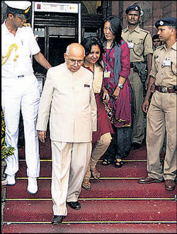 Governor H R Bhardwaj comes out after a meeting with Union Home Minister  P Chidambaram in New Delhi on Wednesday.  PTI