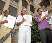 Passed: Council Opposition leader Motamma, JD(S) leaders M C Nanaiah and Y S V Datta showing the copies of Bills passed by ruling party amidst strong protest, in front of Vidhana Soudha in Bangalore on Thursday. dh photo