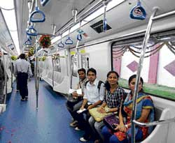Young Bangaloreans get a feel of the Metro as they sit inside  a model coach unveiled in Bangalore on Friday. dh photoYoung Bangaloreans get a feel of the Metro as they sit inside  a model coach unveiled in Bangalore on Friday. dh photo